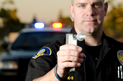 Officer with breathalyzer